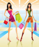 Shopping girls in the mall Stock Images