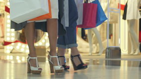 Shopping girls marching in the mall. Close up. Professional shot in 4K resolution. 103. You can use it e.g. in your commercial video, business, presentation stock video footage