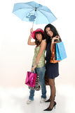 Shopping girls with umbrella Stock Image