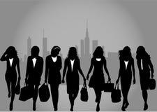 Shopping girls. Urban background. Stock Photo