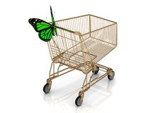 Shopping gold trolley in high definition and green butterfly Royalty Free Stock Photography