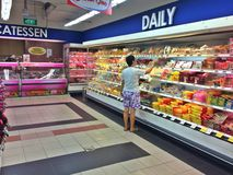 Shopping for groceries at supermarket Royalty Free Stock Photography