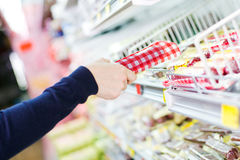 Shopping in grocery store. Customer in grocery store picking a product stock photos
