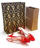 Shopping hänger lös med damtoalett skor arkivfoton