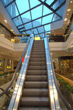 Shopping hall escalator Stock Photos