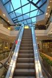 Shopping hall escalator Stock Photos