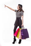 Shopping happy woman gesturing showing copy space at the side. Full length isolated on white background. Royalty Free Stock Photography