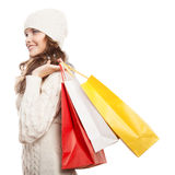 Shopping happy woman holding bags. Winter sales. Royalty Free Stock Photo