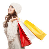 Shopping happy woman holding bags. Winter sales. Royalty Free Stock Image