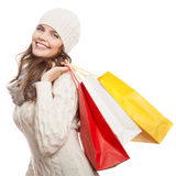 Shopping happy woman holding bags. Winter sales. Isolated Royalty Free Stock Images