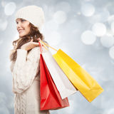 Shopping happy woman holding bags. Winter sales. Stock Photo