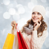 Shopping happy woman holding bags. Winter sales. Royalty Free Stock Photos