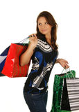 Shopping happy woman. Isolated over white backgrou. Nd Stock Images