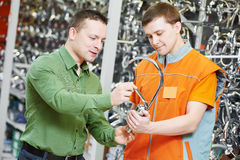 Shopping hardware. assistant helping man choosing taps Stock Photography