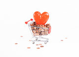 Shopping heart. A heart and eurocents in a shopping cart Stock Photography