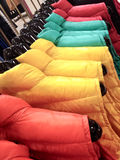 Shopping for her - multicolored coats for winter Royalty Free Stock Photos