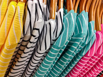 Shopping for her - multicolored stripped shirts royalty free stock photo