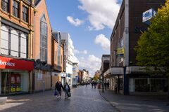 Shopping on the High st in St Helens Merseyside