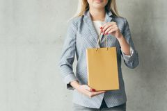 Shopping hobby brown paper bag woman hands stock photo