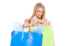 Shopping: Holding Shopping Bags Out To Camera Royalty Free Stock Photo