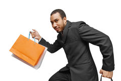 Shopping in a hurry. Happy business man doing shopping in a hurry Stock Photography