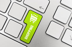 Shopping Icon. Shopping button on modern aluminium keyboard. You may easily change icon color in Adobe Photoshop using Hue/Saturation filter (Ctrl+U on PC or Cmd Royalty Free Stock Photos