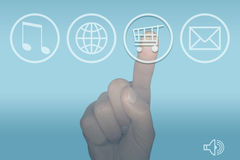 Shopping icon computer touch screen menu and hand. Finger pressing the internet shopping trolley icon on a computer touch screen menu Royalty Free Stock Photos