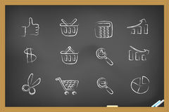 Shopping icons on blackboard Royalty Free Stock Image