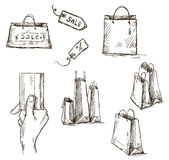Shopping icons, sale tag, paper bags, hand with cr Royalty Free Stock Images