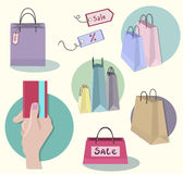 Shopping icons, sale tag, paper bags, hand with cr Stock Image