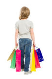 Shopping kid from behind Stock Images