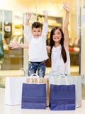 Happy shopping kids Stock Photos