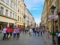 Shopping in Krakow. KRAKOW, POLAND - JULY 20: People goes by Florianska, Main shopping street of Krakow on July 20, 2012. Krakow is one the most beautiful and Royalty Free Stock Photo