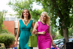 Shopping Ladies. Happy Shopping Friends with bags Royalty Free Stock Photography
