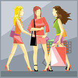 Shopping ladies in red dresses and red Stock Photos
