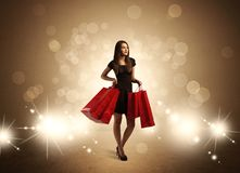 Shopping lady with bags in bright lights Royalty Free Stock Images