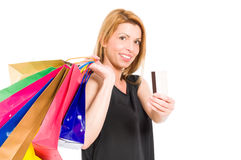 Shopping lady holding shopping bags and credit or debit card Stock Photography