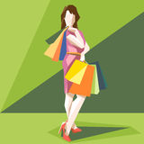 Shopping lady in a pink dress and red shoes Stock Photos
