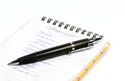 Shopping List. Pen and notebook, handwritten shopping list Royalty Free Stock Photo