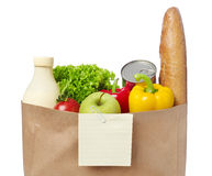 Shopping list on a bag of groceries Royalty Free Stock Photo