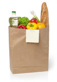 Shopping list on a bag of groceries Stock Image