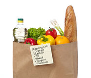 Shopping list on a bag of groceries Stock Images