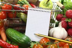 Shopping list with basket and fresh vegetables royalty free stock photo