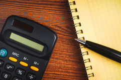 Shopping list with calculator Stock Photography