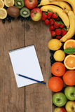 Shopping list and fresh fruits Royalty Free Stock Photos
