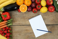 Shopping list with fruits and vegetables Royalty Free Stock Images