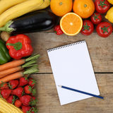 Shopping list with fruits and vegetables on a wooden board Stock Image