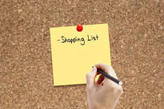 Shopping list. With hand on cork Royalty Free Stock Photography