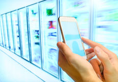 Shopping list on her smartphone at supermarket. Royalty Free Stock Photo