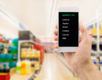 The shopping list in my smartphone Stock Photo